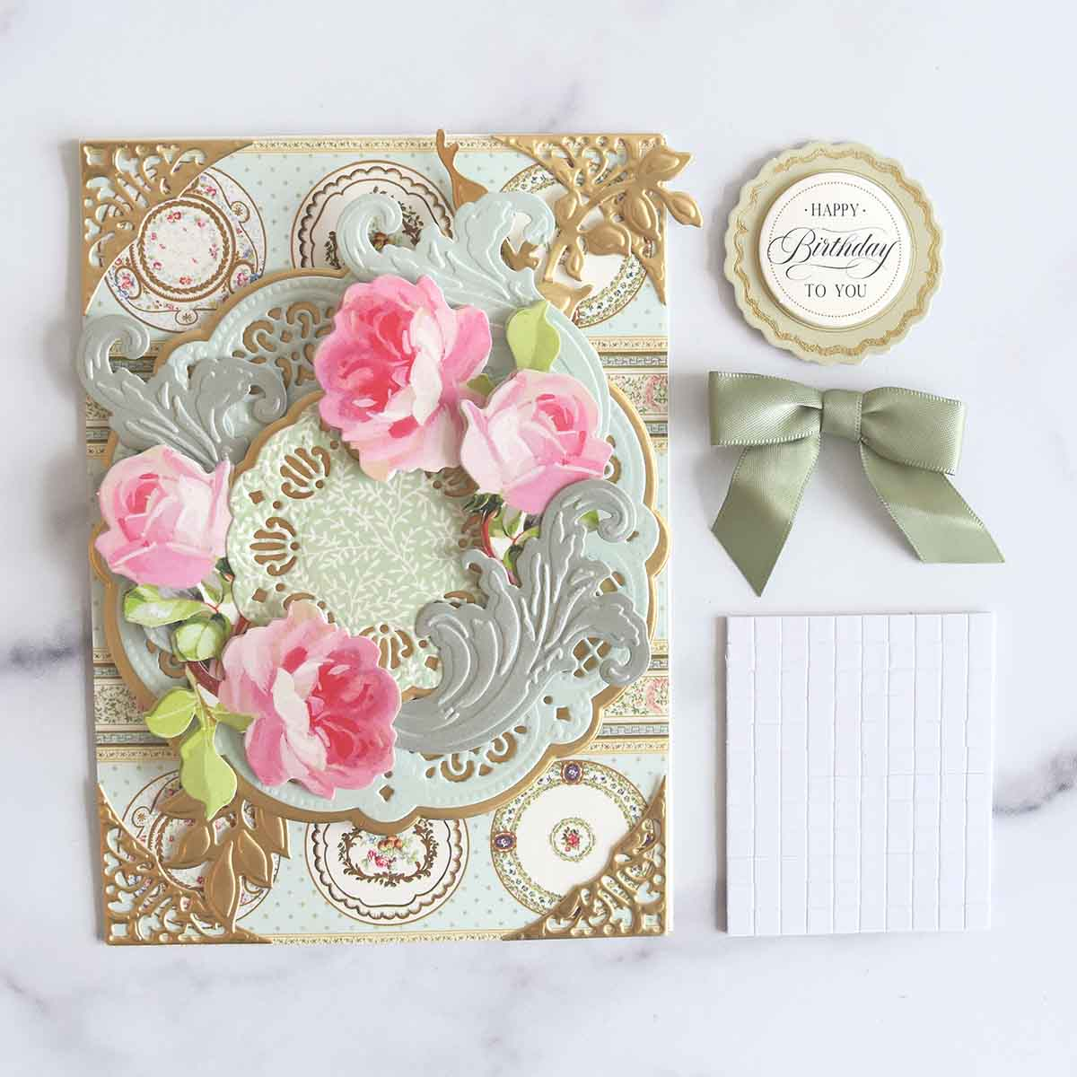 The card base now has the flourishes and roses.