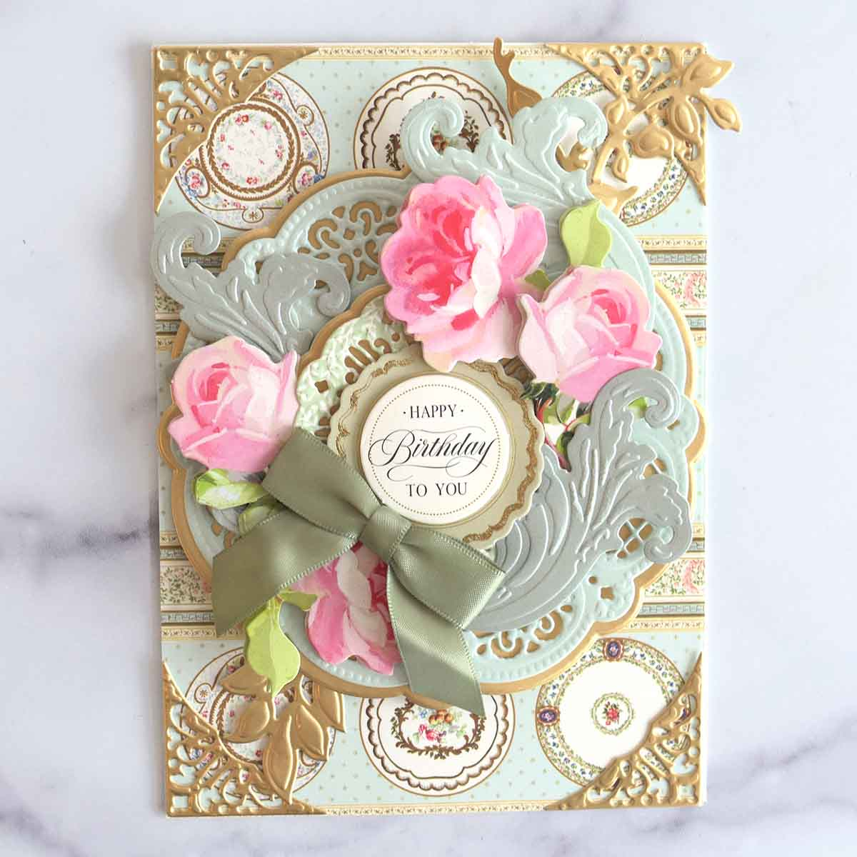 The Happy Birthday to You sentiment and a sage green bow was added to the card to finish it.