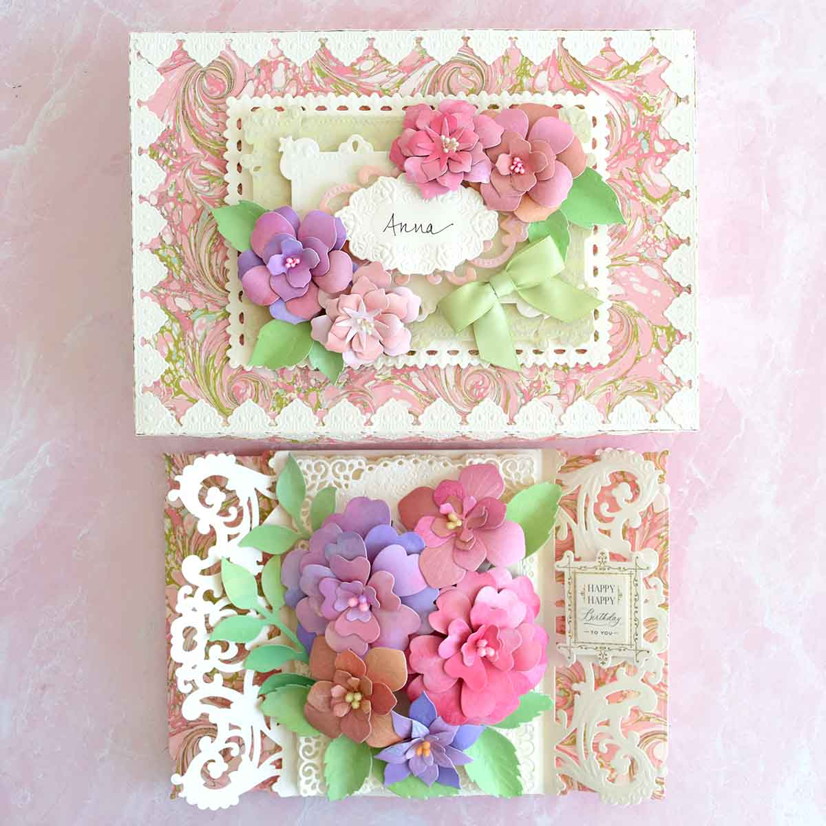 Decorative box made with Anna Griffin Marbleized Cardstock, 3D Decorative Border Dies and Flower Dies. There is a matching card that says Happy, Happy Birthday to You.