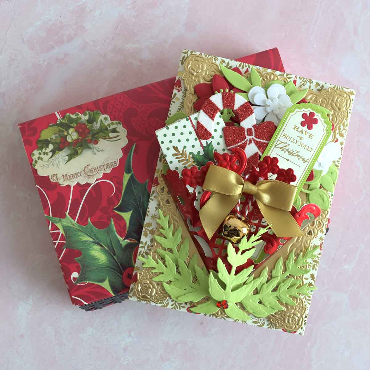 White and gold patterned Christmas card with gold layer, red foil tussy mussy, red and white flowers and a Have a Holly Jolly Christmas sentiment.