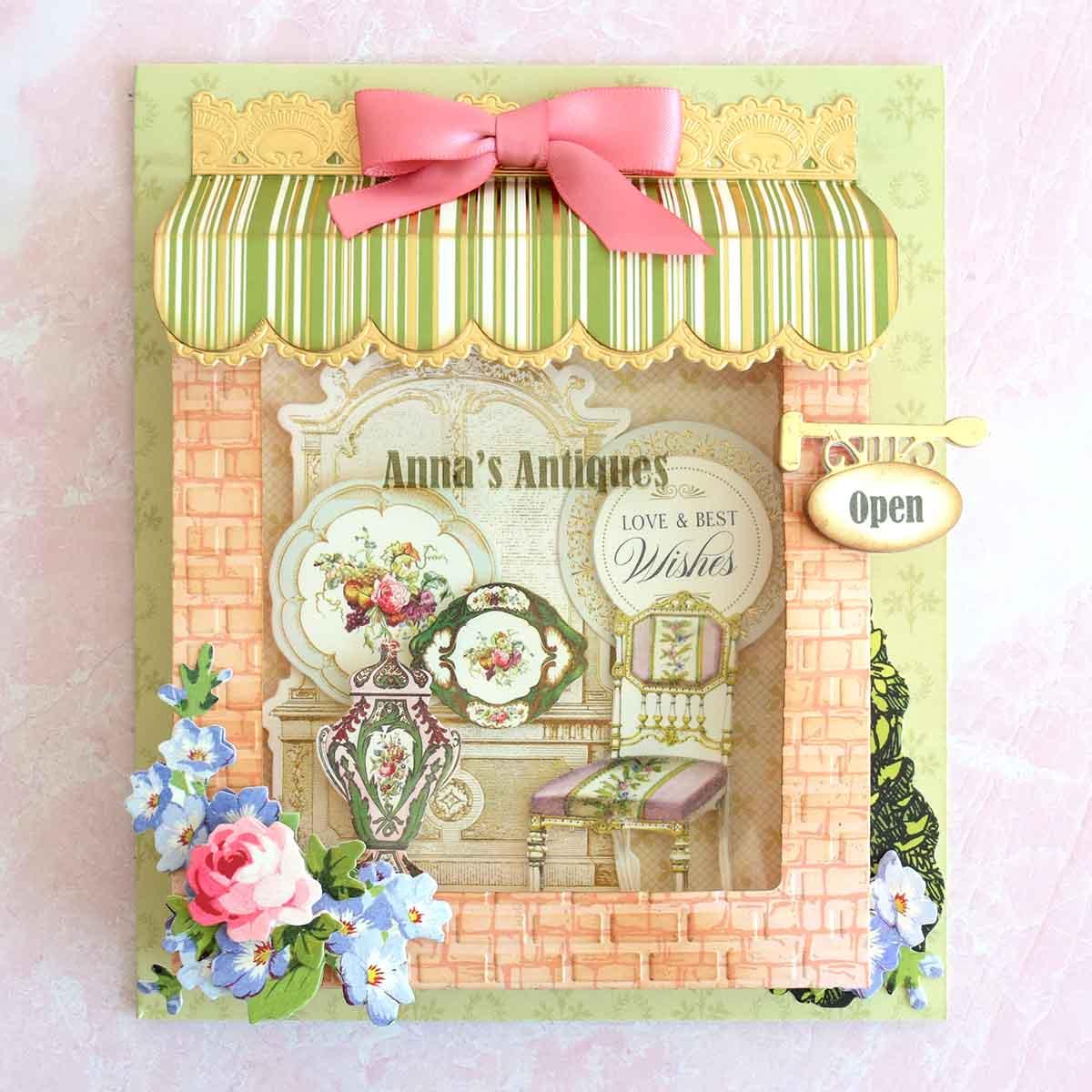 Antique storefront card with vignette inside.