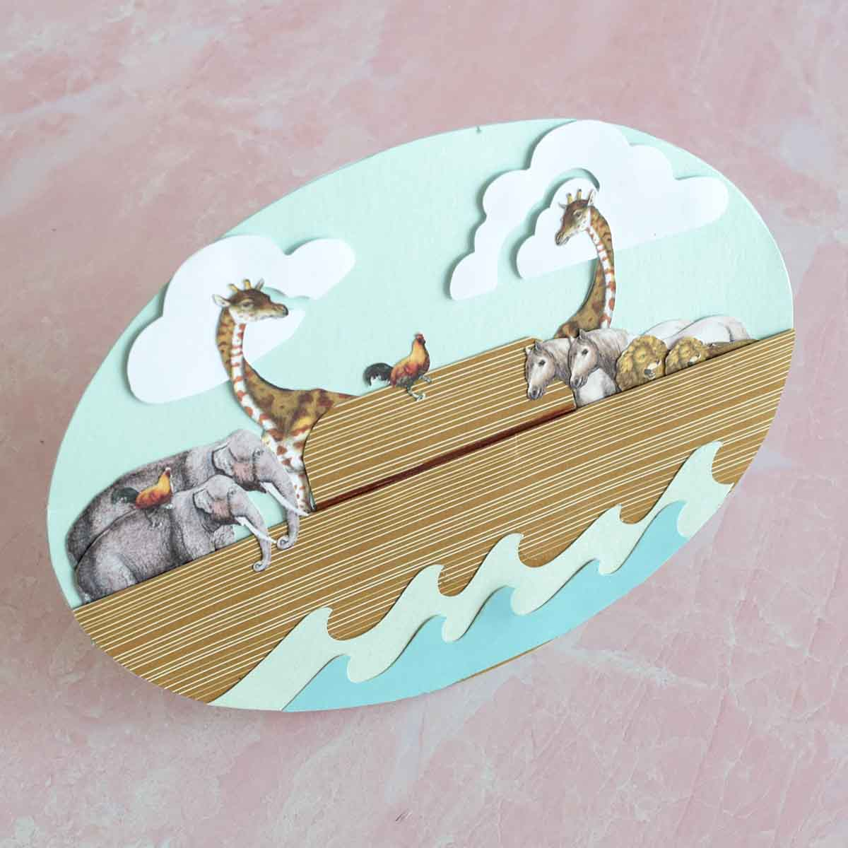 Noah's ark card made with Anna Griffin Rocking Card Dies and AG and Cricut print then cut animals.