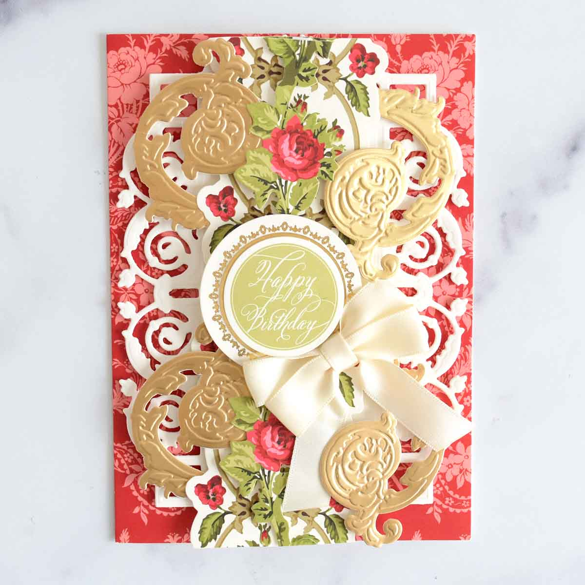 Red floral card base with white layer, floral border sticker, 4 golf flourishes, Happy Birthday sticker and ivory double bow.